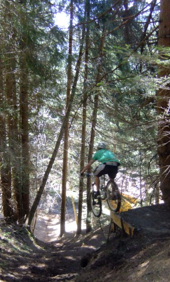 Spencer cruising the drop on the new trail below Planet